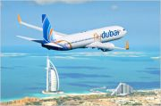 FlyDubai plane over Burj Al Arab and Jumeirah Beach Hotel